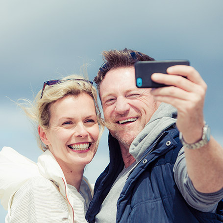 Beyond benefits - older couple taking selfie
