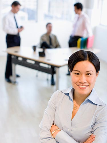 Career area - woman with blurred meeting background