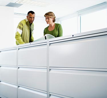 Career area - impromptu meeting around file cabinet