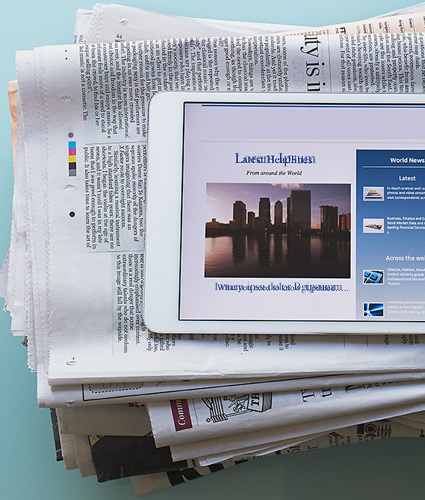 Career area - newspaper and tablet with newspaper front page